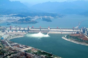 This photo taken on Sunday May 14, 2006 and released by China's official Xinhua news agency, shows a distant view of the giant dam of the Three Gorges hydropower project under construction on the Yangtze River. There are less than 3,000 cubic meters of concrete left to be placed before the dam is finally completed on May 20, nine months ahead of the schedule, Xinhua said. The dam is situated near the Xiling Gorge, the eastern most gorge of the Three Gorges on the middle reaches of the Yangtze River. (AP Photo/Xinhua, Du Huaju)